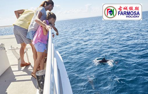 A family enjoys whale and dolphin cruise at Nelson Bay, Port Stephens